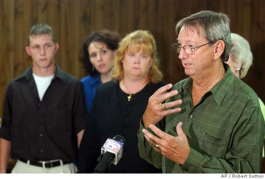 Jimmy Montgomery, surrounded by family, speaks to the media following the execution of James Barney Hubbard on Thursday evening, Aug. 5, 2004, in Atmore, Ala. Hubbard was convicted for the murder of Lillian Montgomery, Jimmy Montgomery's mother, and was executed by lethal injection at Holman Correctional Facility near Atmore, Ala. Hubard has been on death row for over 26 years, and is the oldest prisoner to be executed in the United States since the U.S. permitted executions to resume in 1976. (AP Photo/Tuscaloosa News, Robert Sutton) Photo: ROBERT SUTTON