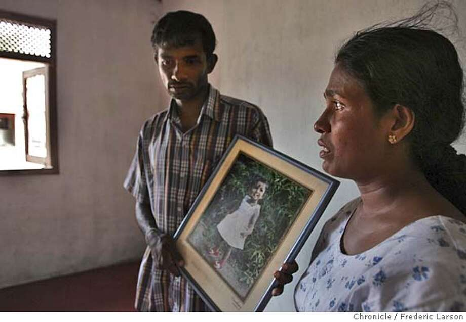 TSUNAMI_D310_fl.jpg Kumar Eadivira and his wife Renuka remember the lost of all three of their daughters that where swept away by the Tsunami in Tagalle, Sli Lanka. Kumar holds a photo of Umauange Dansane, daughter (3) (age one when photo was taken) that he could not hold on to when the second wave hit his house. Kumar lives in a prosperous little enclave of fisherman's home and tourist guest house near the a beautiful beach setting. The Tsunami that hit southeast Asia December 26th totals over 200K dead, thousands still missing and over two thirds of the shoreline and its immediate vicinity destroyed. Nearly a million are displaced and dispossessed from the tragedy that struck Sli Lanka where local residents are slowly beginning to clear away debris as the county comes to terms with the terrible lost that affected the Slli Lankan coastline. Thousands of Shi Lankan residents mostly front small fishing villages near the ocean front are homeless from the powerful Tsunami the killed up to 200K in Southeast Asia. 12-26-04. 1/19/05 Frederic Larson  The San Francisco Chronicle For: TSUNAMI_Tangalle Photo: Frederic Larson