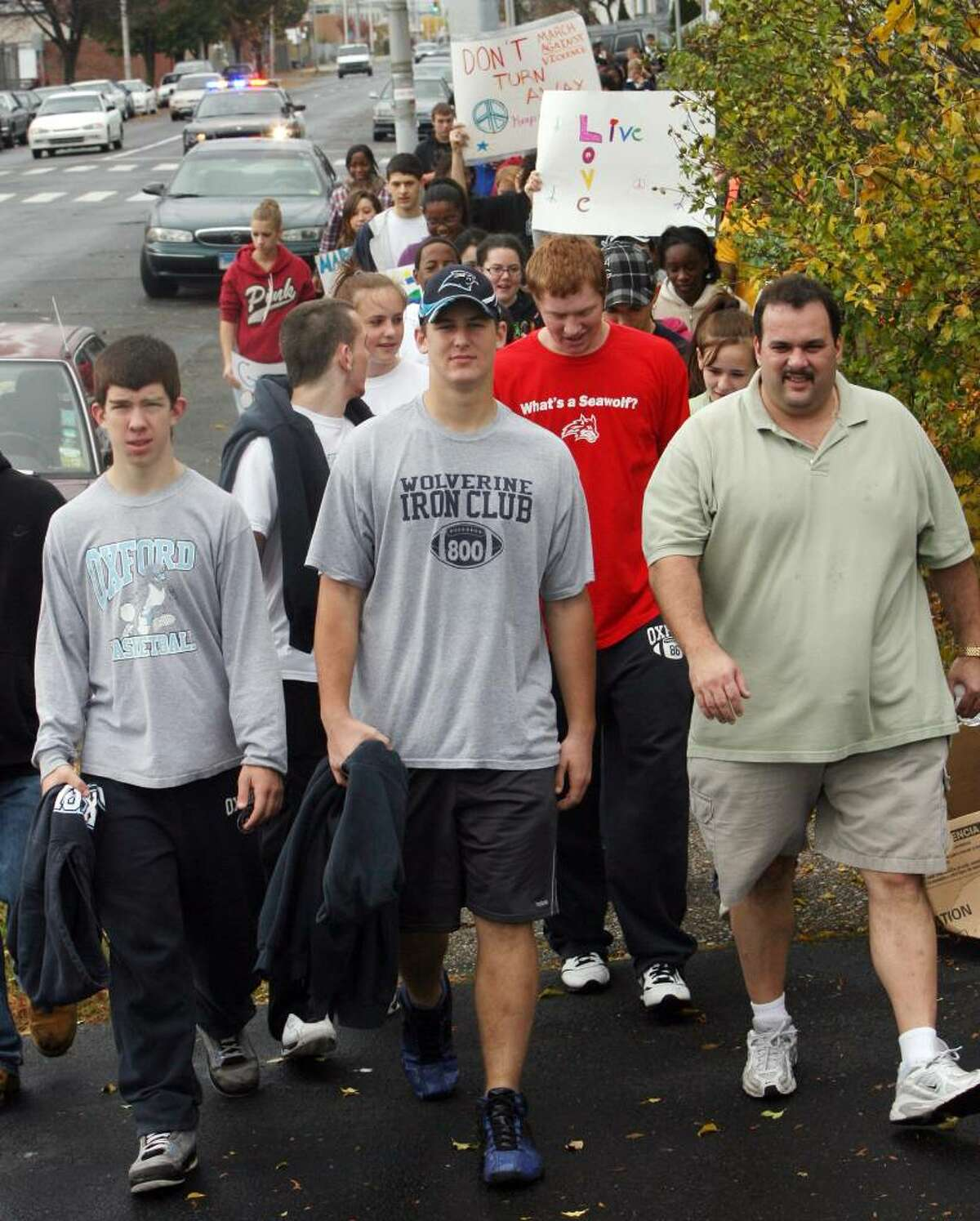 Oxford High School teacher and former Bassick teacher Jeff Giovacchino, right, walks with students in memory of his former Bassick High School student , Ta Von Duharte, who was killed in 2006 in Bridgeport. Students from Bassick, Oxford and members of Build On, a worldwide community service club, joined in a March Against Violence on Saturday, Oct.31, 2009. The walk was a 2.5 mile loop around Bassick High school and included Hancock street, where Duharte was killed.