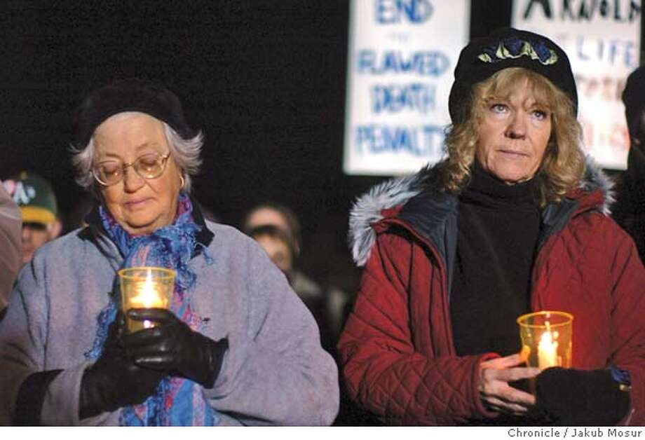 ExecutionProtest_05.JPG Elizabeth Kemp and Cindy Loscotoff stand in protest against the execution of condemned murderer Donald Beardslee, who killed two young Peninsula women in 1981 while on parole from an earlier murder conviction, outside San Quentin State Prison.  Event on 1/18/05 in San Quentin. JAKUB MOSUR / The Chronicle MANDATORY CREDIT FOR PHOTOG AND SF CHRONICLE/ -MAGS OUT Photo: JAKUB MOSUR