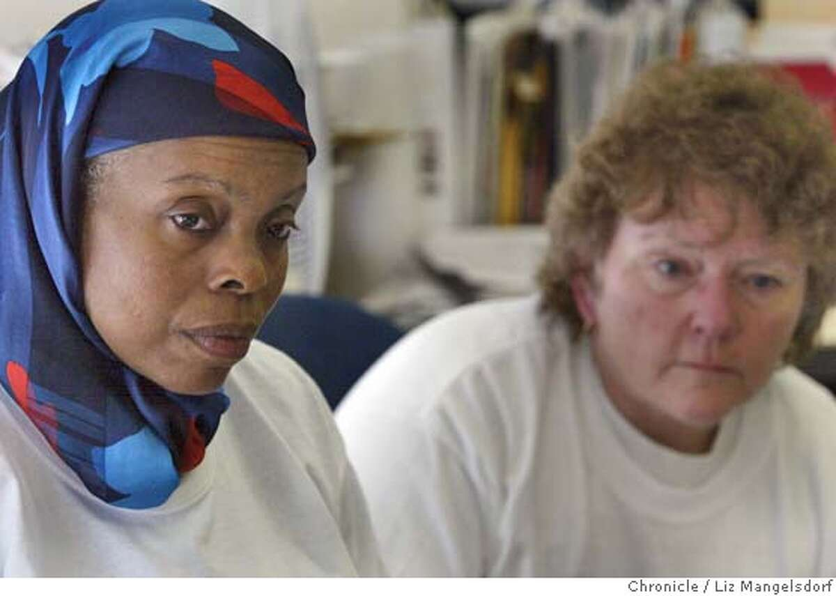 Event on 7/30/04 in Oakland. Yvonne Cooks, left, and Linda Evans, listen to the discussion during a meeting of the the group
