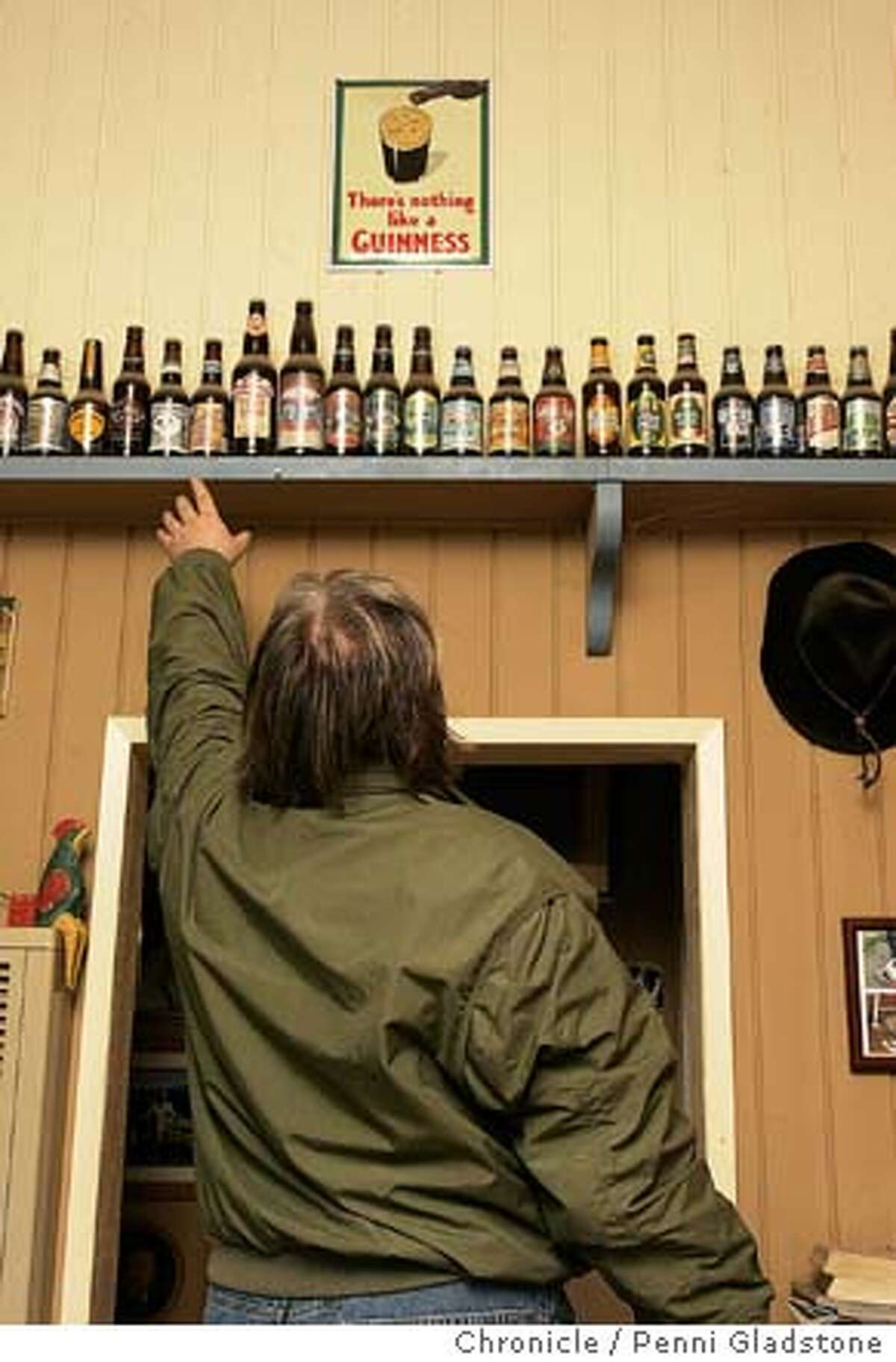 NBSPARKS195PG.JPG Sparks shows off his collection of beer bottles in his livingroom. Steve Sparks, a Brit who used to own the Mad Dog in the Fog pub in the Lower Haight. He and his wife up and moved to Mendocino The San Francisco Chronicle, Penni Gladstone Photo taken on 1/10/05, in Mendocino, CA.
