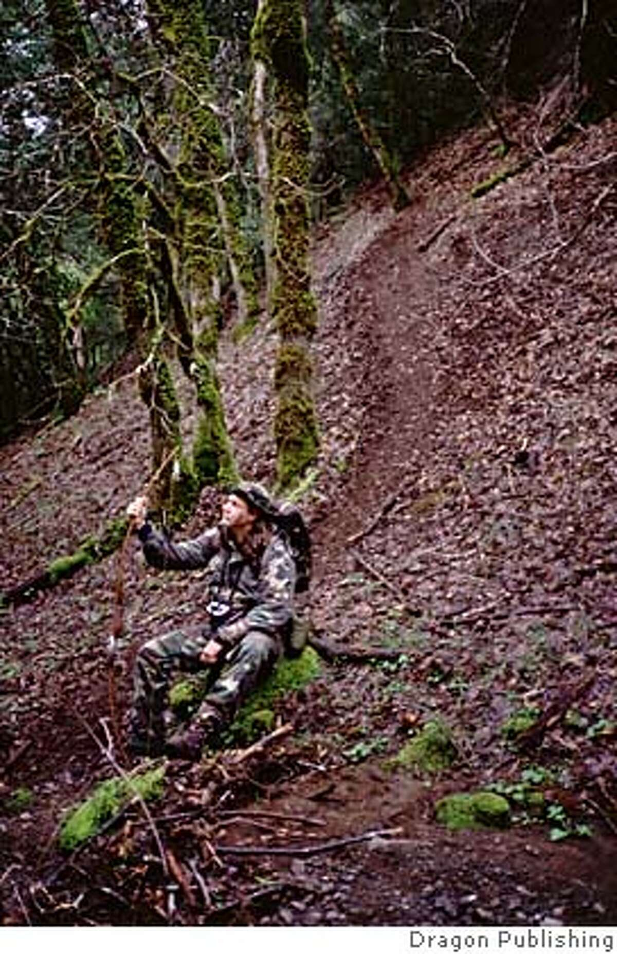 """Game writer and lecturer Frederick """"Cork"""" Graham prepares to take his longbow up a pig trail in the California hills."""