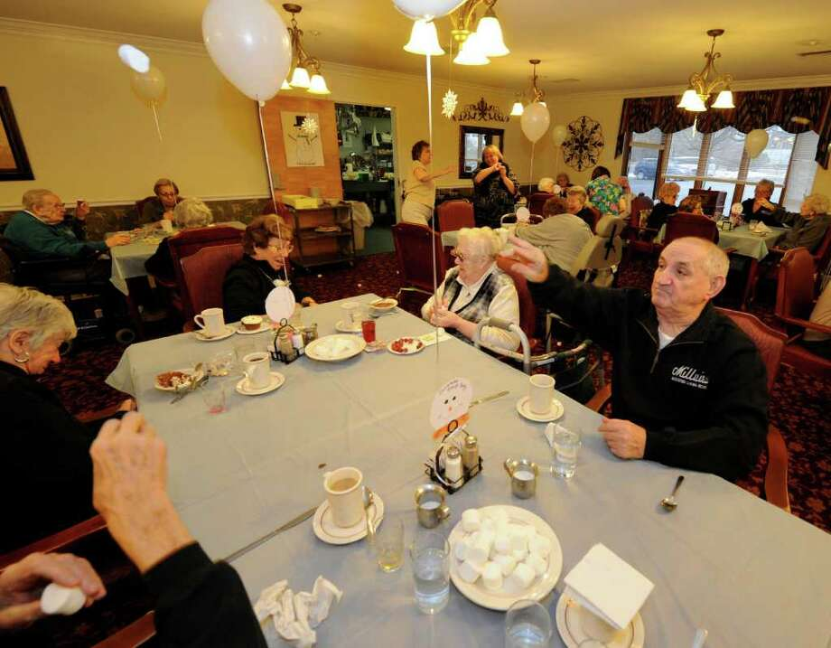 "Residents of Millview Assisted Living in Cohoes, N.Y. get in to the annual ""snowball"" fight using marshmallows to ward away the winter doldrums Jan. 25, 2012.  (Skip Dickstein / Times Union) Photo: SKIP DICKSTEIN / 00016187A"