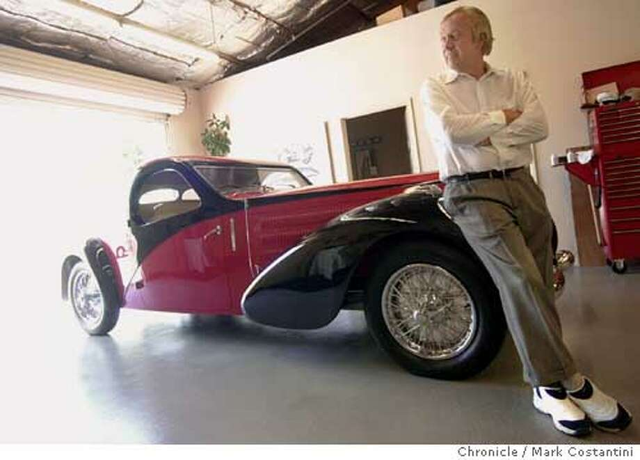 Don Williams leans against his 1938 Bugatti Type 57 Atalante Coupe. Chronicle photo by Mark Costantini