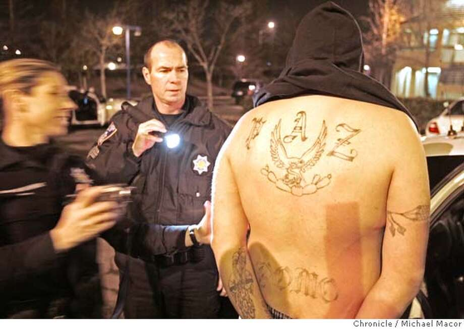 gangs_206_mac.jpg Santa Rose police arrest a man who was resisting arrrest as well as pocessing an illegal weapon in the parking lot of the Motel 6 downtown. Police believe he has affiliations with Santa Rosa gangs. Ride-A-Long with MAGNET gang task force, which is trying to put pressure on Sonoma County's 35 gangs and some 3,000 gang members, after a series of violent crimes including a homicide on New Years Eve.1/14/05 Santa Rosa, Ca Michael Macor / San Francisco Chronicle Mandatory Credit for Photographer and San Francisco Chronicle/ - Magazine Out Photo: Michael Macor