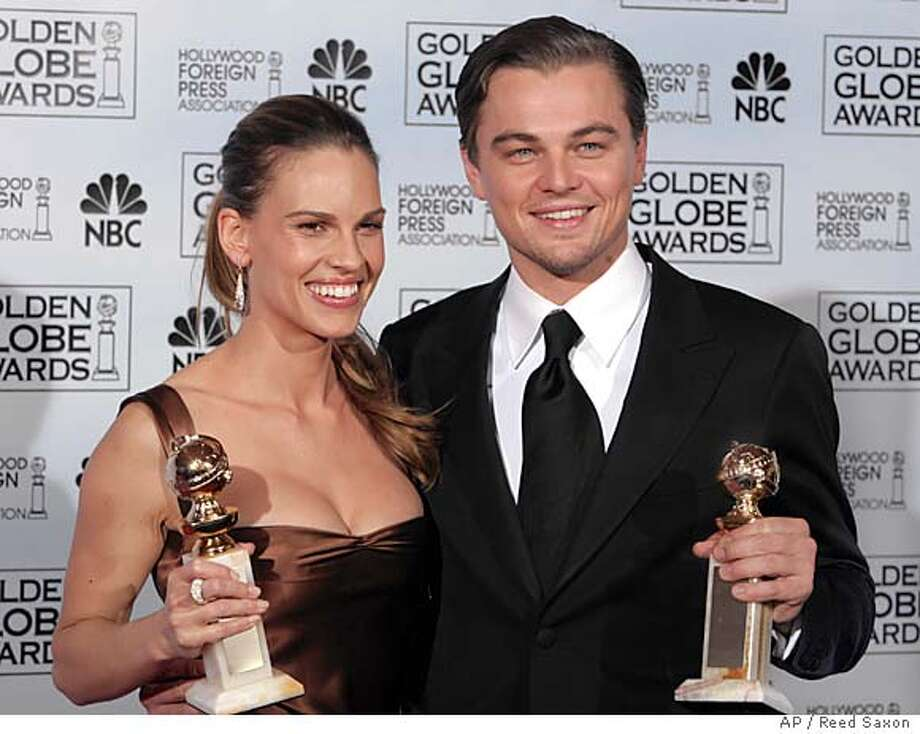 Hilary Swank poses with the award she won for best actress in a drama for her work in Million Dollar Baby, and Leonardo DiCaprio poses with the award he won for best actor in a drama for his work in The Aviator, at the 62nd Annual Golden Globe Awards on Sunday, Jan. 16, 2005, in Beverly Hills, Calif. (AP Photo/Reed Saxon) Photo: REED SAXON