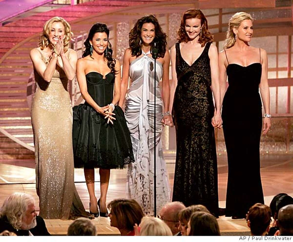 """Cast members from the nominated television series """"Desperate Housewives,"""" from left, Felicity Huffman, Eva Longoria, Teri Hatcher, Marcia Cross and Nicolette Sheridan make a presentation at the 62nd Annual Golden Globe Awards on Sunday, Jan. 16, 2005, in Beverly Hills, Calif. (AP Photo/NBC, Paul Drinkwater)"""