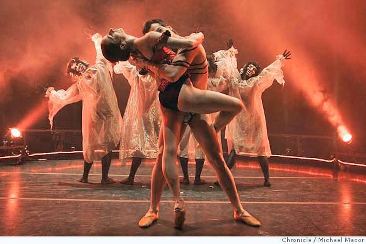 """Tina Kay Bohnstedt and Jekyns Pelaez, with The Masks behind them. The Diablo Ballet Company, dress rehearsals for their upcoming production of ,""""Carmen"""", at Zellerbach Hall, UC Berkeley. 1/15/05 Berkeley, Ca Michael Macor / San Francisco Chronicle"""