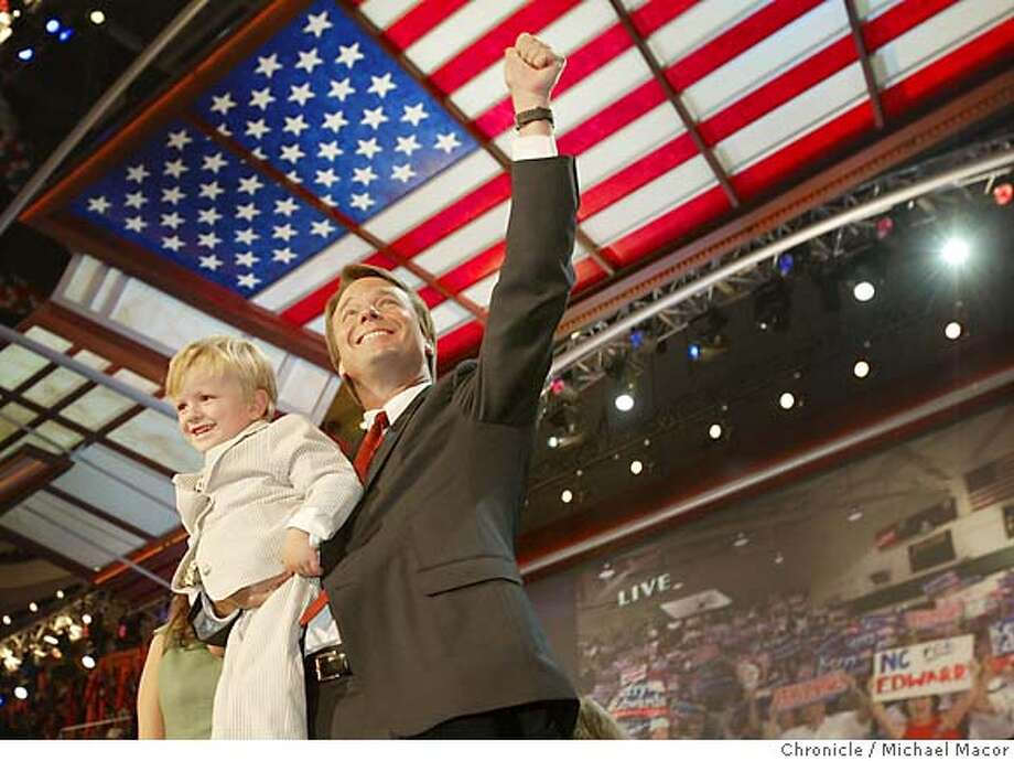 Vice Presidential Candidate John Edwards holds his son Jack at the end of his address. The 2004 Democratic National Convention. 7/28/04 in Boston Michael Macor/San Francisco Chronicle Photo: Michael Macor