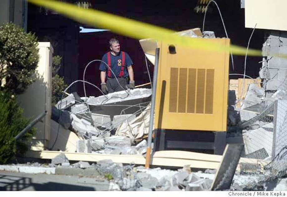 Two people were left dead after their van crashed into a garage at the administration office of the Bay Bridge toll plaza Saturday.  MIKE KEPKA/The Chronicle Photo: MIKE KEPKA
