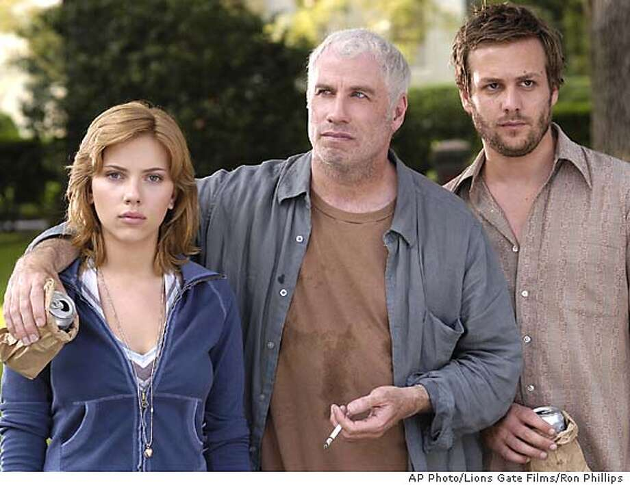 """In this photo provided by Lions Gate Films, Pursy Will (Scarlett Johansson), returns to New Orleans for the first time in years only to discover that it is inhabited inhabited by two of her mother's friends, Bobby Long (John Travolta) and Lawson Pines (Gabriel Macht) , in """"A Love Song for Bobby Long."""" (AP Photo/Lions Gate Films/Ron Phillips) Photo: RON PHILLIPS"""