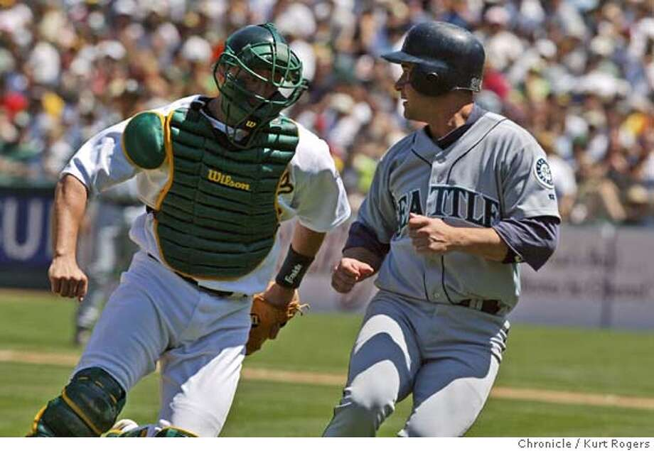 Damian Miller ran down Bret Boone in the 8th .  The Seattle Mariners vs. The Oakland Atthletics at Network Associates Coliseum . 7/28/05 in Oakland,CA.  Kurt Rogers/The Chronicle Photo: Kurt Rogers