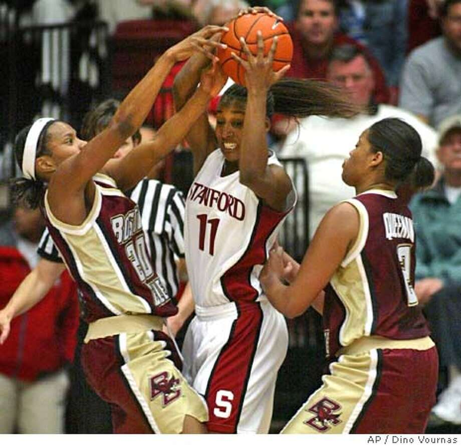 Stanford's Candice Wiggins (11) struggles with Boston College's Aja Parham, left, and Brooke Queenan during the second half Saturday, Jan. 15, 2005, in Stanford, Calif. (AP Photo/Dino Vournas) Photo: DINO VOURNAS
