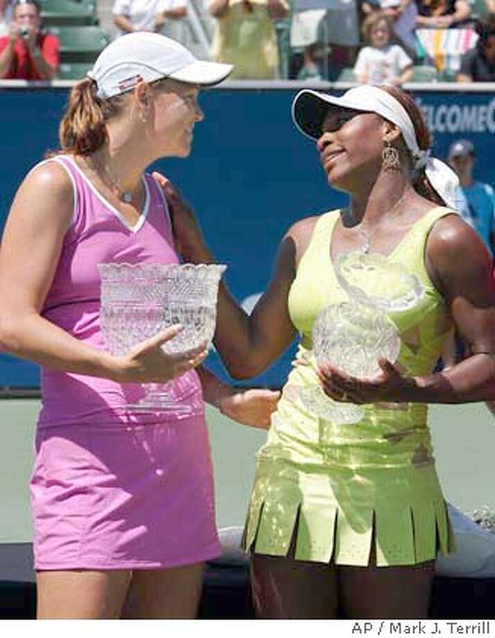 Serena Williams congratulates Lindsay Davenport after Davenport won their final match, Sunday, July 25, 2004, in Carson, Calif. Davenport won 6-1, 6-3. (AP Photo/Mark J. Terrill) Photo: MARK J. TERRILL