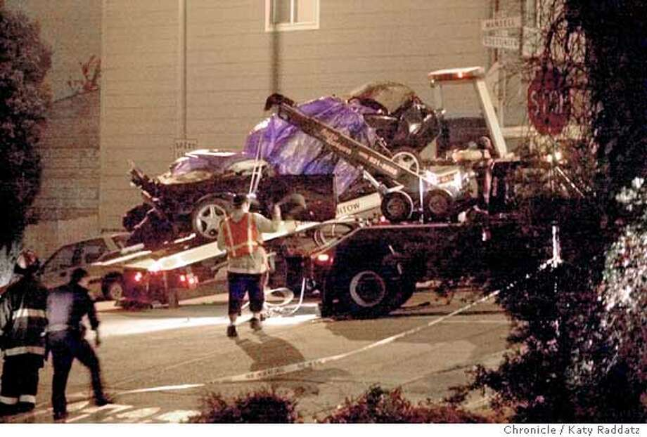 A tow truck driver removes a vehicle from the scene of a vehicle accident that left 4 dead at the corner of Mansell and Goettingen in the Bayview neighborhood of San Francisco, Ca., on Monday, July 26, 2004. Photo: Katy Raddatz