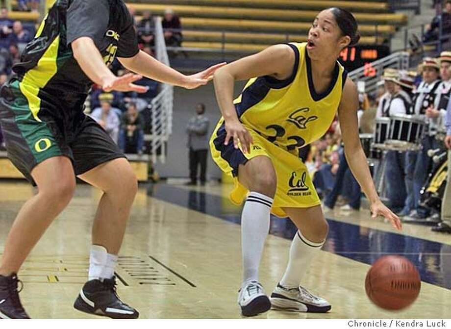 CALWOMEN2-C-10FEB01-SP-KL --- University of California's (#33) Latasha O'Keith looks for an open teammate as Oregon's Lindsey Dion (#23) puts on the pressure during the first half of their match up Saturday night at Cal.  (KENDRA LUCK/SAN FRANCISCO CHRONICLE) Photo: CALWOMEN2-C-10FEB01-SP-KL