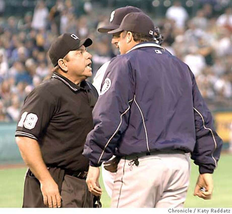 SHOWN: Home plate umpire Charlie Reliford throws out Seattle pitching coach Bryan Price after Price argued a strike call in the bottom of the 4th inning. Athletics (Oakland A's) v. Seattle Mariners at Oakland. Katy Raddatz / The Chronicle Photo: Katy Raddatz