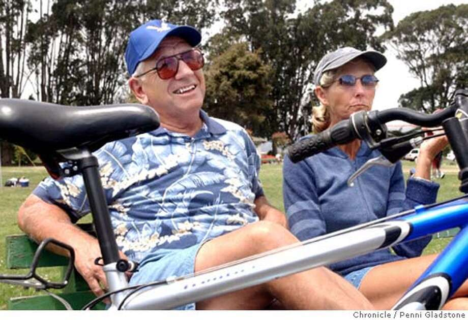 Al and Laurel George are from Woodlake, CA. They are avid bike riders and here on vacation.  LANCE Armstrong won his 6th Tour de France today. We get reaction from bike riders near Crissy Field in the Marina.  7/25/04 in San Francisco.  Penni Gladstone / The Chronicle Photo: Penni Gladstone