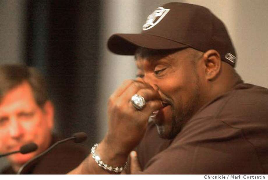 RAIDERS23_0044.JPG Photo taken on 3/22/04 in Alameda. Seven Time Pro Bowl defensive tackle Warren Sapp(right) has a laugh at his press conference at the Oakland Raiders headquarters. He was signed to play on the team. In the background is Raiders head Coach Norv Turner. On his hand is his Sper Bowl ring -- from when his old team beat the Raiders. CHRONICLE PHOTO BY MARK COSTANTINI MANDATORY CREDIT FOR PHOTOG AND SF CHRONICLE/ -MAGS OUT Photo: MARK COSTANTINI