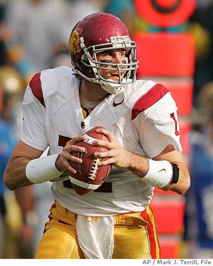 ** FILE ** University of Southern California quarterback Matt Leinart gets set to pass during the first half against UCLA, in this, Dec. 4, 2004 file photo in Pasadena, Calif. Leinart was selected as the AP college football player of the year on Thursday, Dec. 23, 2004. (AP Photo/Mark J. Terrill) Ran on: 12-24-2004 Ran on: 12-24-2004 A DEC. 4, 2004 FILE PHOTO Photo: MARK J. TERRILL