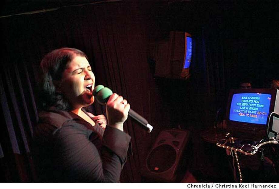 """CHRISTINA KOCI HERNANDEZ/CHRONICLE  Juanita Nessinger takes the stage at The Mint, singing """"Like A Virgin"""" .The Mint has a really diverse crowd of karaoke singers, both average people  and ringers. 11 p.m. is peak time. And Do Re Me in Japantown is apparently the oldest karaoke club in the Bay Area and also draws a mixed crowd. MANDATORY CREDIT FOR PHOTOG AND SF CHRONICLE/ -MAGS OUT Photo: CHRISTINA KOCI HERNANDEZ"""