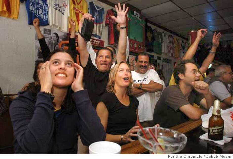 Patricia Araujo, left, originally from Bogota, Columbia, reacts with other soccer fans at the El Farolito Bar to Brazil's 4-2 win against Argentina in the Copa America on Sunday, 7/25/04 in San Francisco. JAKUB MOSUR / The Chronicle Photo: JAKUB MOSUR