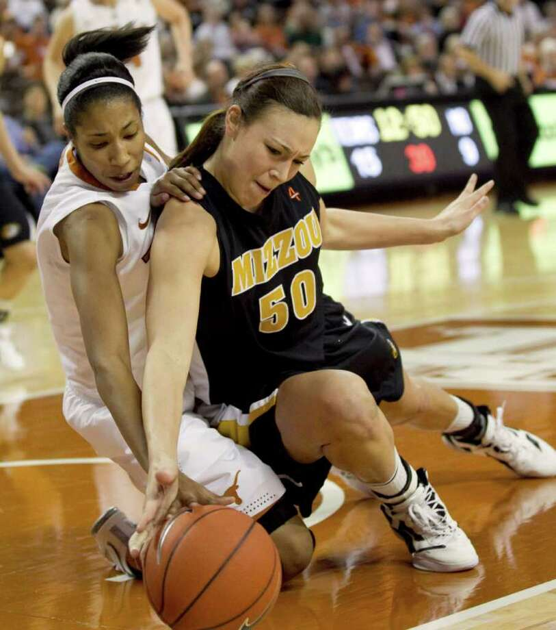 Texas' Chelsea Bass (left) and Missouri's Christine Flores, a former Churchill star, fight for a loose ball in the first half. Photo: AP