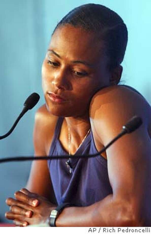 Marion Jones pauses as she address the media to explain that she will be pulling out of the 200 meter competition to concentrate on the long jump and the relays during the Olympic Track and Field trials in Sacramento, Calif., Saturday, July 17, 2004. (AP Photo/Rich Pedroncelli) Photo: RICH PEDRONCELLI