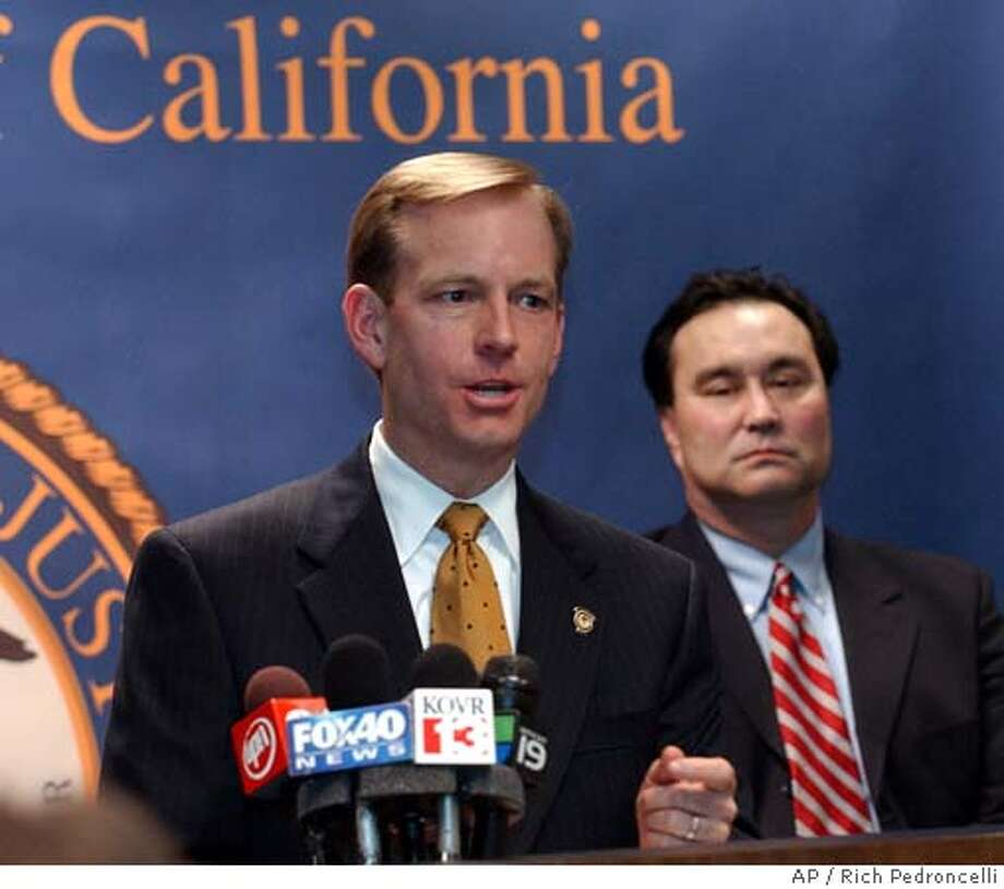 McGregor Scott, left, United States attorney for the Eastern District, discusses the plea agreement made with San Joaquin County Sheriff T. Baxter Dunn and former San Joaquin County Supervisor Lynn Bedford, at a news conference in Sacramento, Calif., Thursday, Jan. 13, 2005. Dunn, who faces up to 18 months in prison, pleaded guilty to a federal fraud charge and agreed to resign his post and testify against another defendent in a corruption case that targeted several public officials. Bedford faces up to a year in prison after pleading guilty to a count of lying to federal officers. The two were among a group of men accused of having a secret involvement in a company that wanted to build a power plant at the Port of Stockton. At right is David Picard,assistant special agent in charge of the Federal Bureau of Investigation. (AP Photo/Rich Pedroncelli) Photo: RICH PEDRONCELLI
