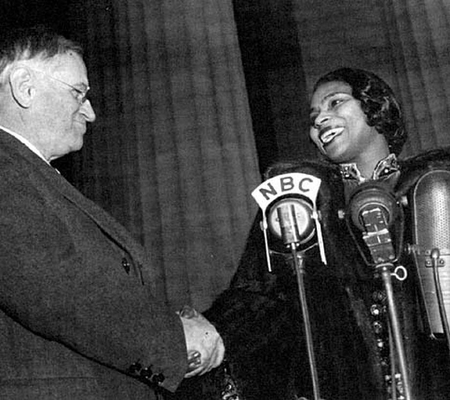 "Marian Anderson is greeted by Interior Secretary Harold L. Ickes before performing at the Lincoln Memorial on April 9, 1939. Photo from ""The Voice That Challenged a Nation'"