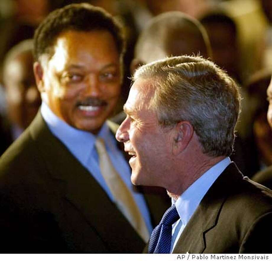 President Bush, right, and Rev. Jessie Jackson, left, shown together after Bush delivered a speech at the National Urban League Conference Friday, July 23, 2004, in Detroit, Mich. (AP Photo/Pablo Martinez Monsivais) Photo: PABLO MARTINEZ MONSIVAIS