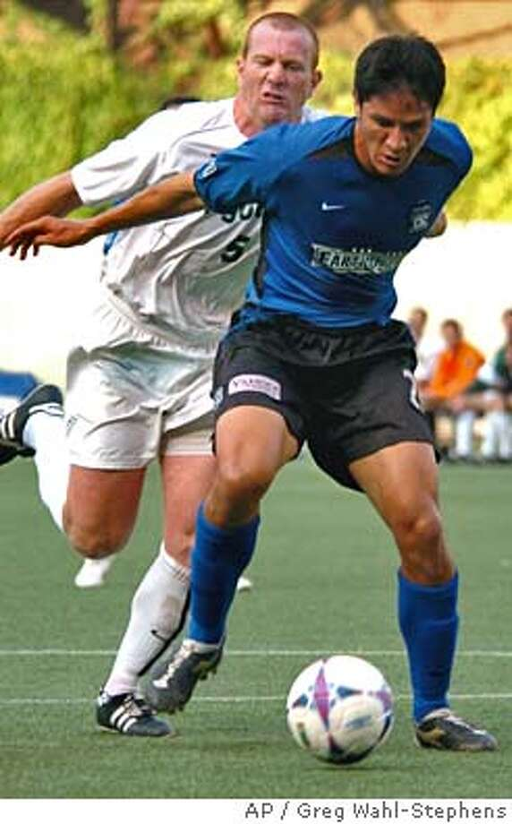 Portland Timbers' Gavin Wilkinson, left, fouls San Jose Earthquakes' Brian Ching in the penalty box during the first half of their U.S. Open Cup match Wednesday, July 14, 2004, in Portland, Ore. San Jose scored from the resulting penalty. (AP Photo/Greg Wahl-Stephens) Photo: GREG WAHL-STEPHENS