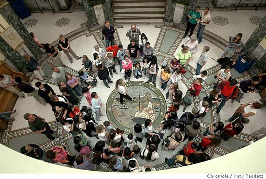 SHOWN: Students group around Carmen Blair (in center, wearing striped shirt), the Director of Education for the San Mateo County History Museum, while she explains the features of the rotunda before leading the group upstairs for the mock trials. Public summer school for G.A.T.E. (gifted and talented kids) kids. The program has kids from several different schools on the peninsula. The entire group goes to the San Mateo County History Museum in Redwood City; they admire the big dome in the rotunda, and have several mock trials in notorious Courtroom A. Shoot date is 7/14/04; reporter is Chris Heredia. Katy Raddatz / The Chronicle Photo: Katy Raddatz
