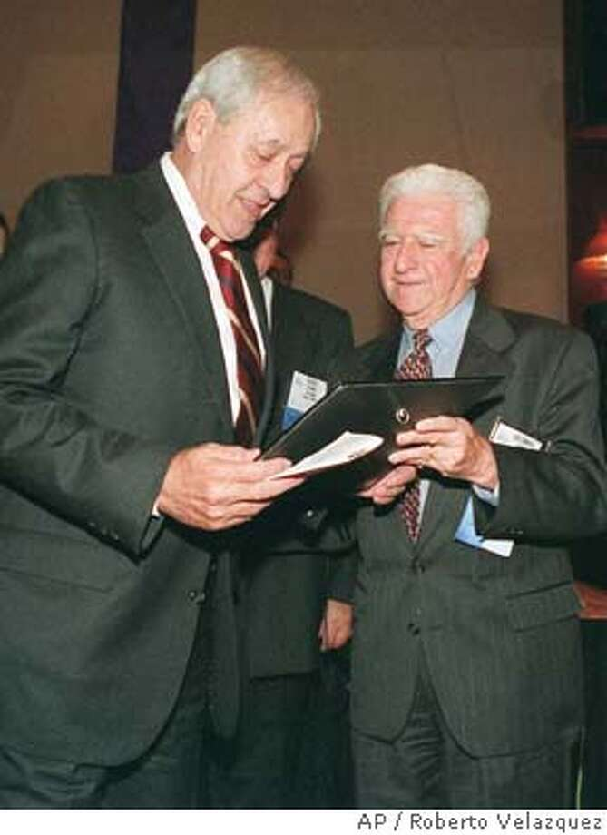 American journalist Elie Abel, left, is received the Inter American Press Society's 1997 Grand Prize for Freedom, from IAPA's outgoing president Colombian Luis Gabriel Cano in the Mexican city of Guadalajara, Wednesday, Oct. 22, 1997, during the clossing session of the society's annual assembly. (AP Photo/Roberto Velazquez) Photo: ROBERTO VELAZQUEZ
