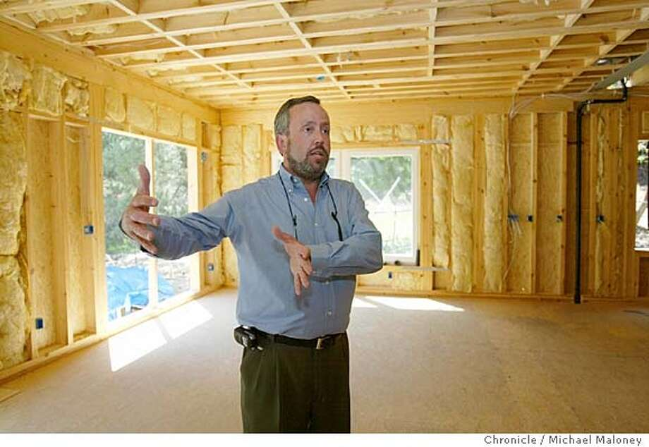 Michael Murray, CEO of the Forma Group in one of his firm's pre-fab homes being constructed in Danville.  The latest wrinkle in prefab homes is called the Swedish System. Manufactured in Estonia, the new systrem is essential a collection of wall panels, floor panels and trusses. On site, the panels are lifted into place by crane. What takes weeks of work on a traditionally built home is cut to days using this system. This home is being assembled in Danville. Michael Murray is the CEO of the firm's US operations.  Photo by Michael Maloney / San Francisco Chronicle Photo: Michael Maloney