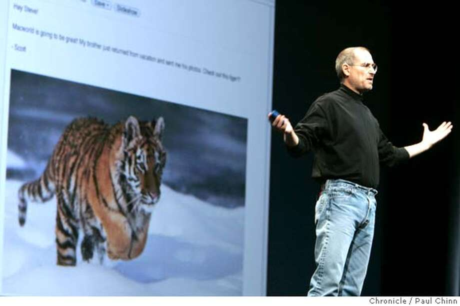 "macworld12_038_pc.jpg  Steve Jobs announced the latest version of OS X ""Tiger"" which features an improved Mail program (left). Apple CEO Steve Jobs unveiled the new Mac Mini desktop computer and the iPod Shuffle during his keynote speech at the 2005 Macworld show on 1/11/05 in San Francisco, CA.  PAUL CHINN/The Chronicle MANDATORY CREDIT FOR PHOTOG AND S.F. CHRONICLE/ - MAGS OUT Photo: PAUL CHINN"
