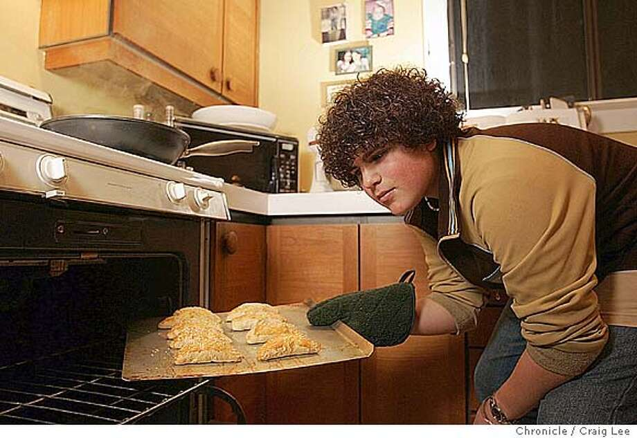 Photo of Max Burstein, a 13-year-old who cooks on a very advanced level for his age. He lives in Berkeley. Photo of Max checking his Greek half-moon cheese pies with feta, raisins, mint and pine nuts.  Event on 1/6/05 in Berkeley. Craig Lee / The Chronicle Photo: Craig Lee