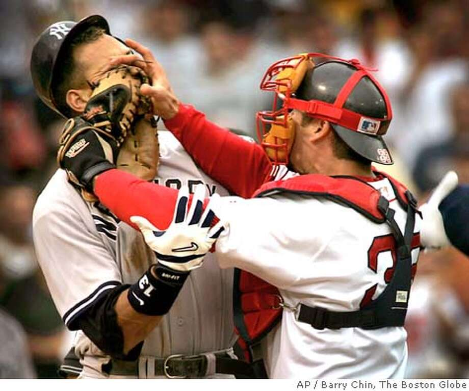New York Yankees' Alex Rodriguez, left, is pushed by Boston Red Sox catcher Jason Varitek, right, after Rodriguez was hit by a pitch from Red pitcher Bronson Arroyo in the third inning at Boston's Fenway Park, Saturday, July 24, 2004. Rodriguez and Varitek were ejected from the game. (AP Photo/Barry Chin, The Boston Globe) BOSTON OUT QUINCY OUT MAGS OUT MANDATORY CREDIT Photo: BARRY CHIN