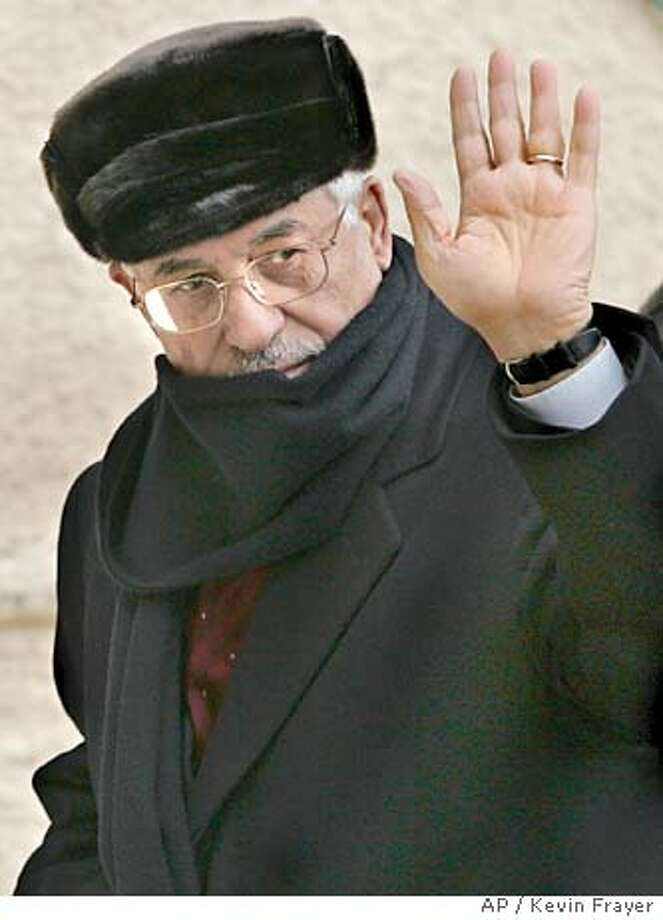 Interim Palestinian leader Mahmoud Abbas, also known as Abu Mazen, waves as he arrives at Yasser Arafat's former headquarters in the West Bank town of Ramallah, Monday, Jan. 10, 2005. Abbas was elected Palestinian Authority president by a landslide, partial results showed Monday, giving the pragmatist a mandate to resume peace talks with Israel, but also leaving him with the tough task of reining in powerful armed groups.(AP Photo/Kevin Frayer) Photo: KEVIN FRAYER