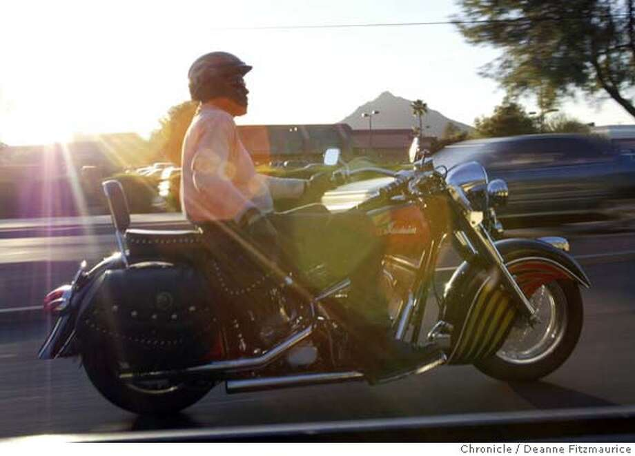 DUSTY19-C-20MAR02-SP-DF  After a spring training game, Dusty Baker, SF Giants manager, rides his Indian motorcycle back to the home where he and his family are staying during spring training in Scottsdale, Arizona.  CHRONICLE PHOTO BY DEANNE FITZMAURICE Photo: DEANNE FITZMAURICE