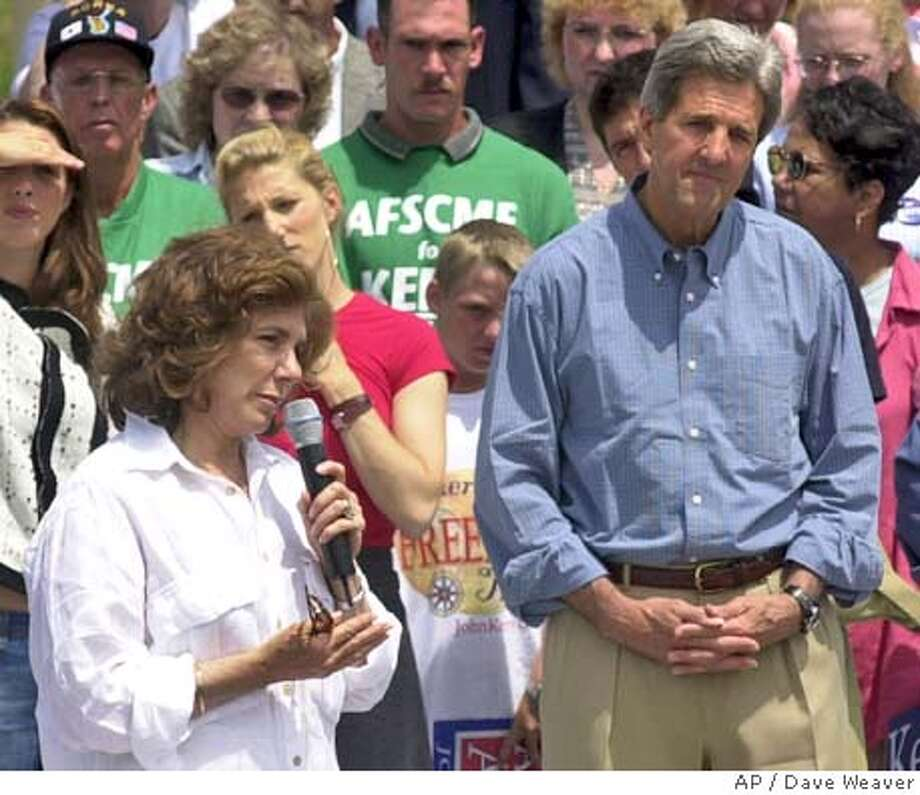 Democratic presidential candidate John Kerry, left, listens to his wife Teresa Heinz Kerry speak Saturday, July 24, 2004, at a rally in Souix City, Iowa. (AP Photo/Dave Weaver) Photo: DAVE WEAVER