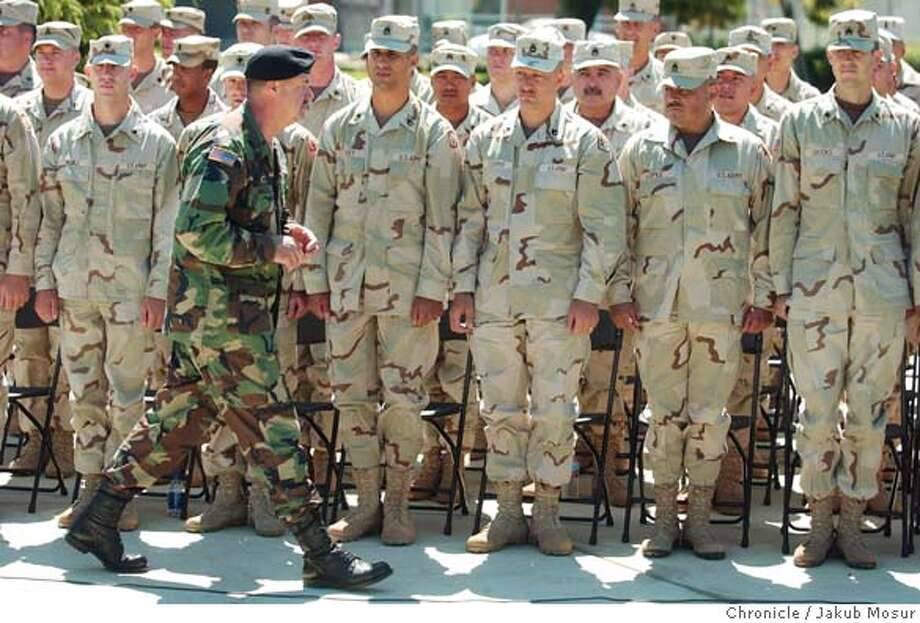 The 870th Military Police Company of the California Army National Guard wait to receive their medals during a welcome home from Iraq ceremony on Saturday,7/24/04 in Pittsburg. The 870th Military Police Company had guarded the Abu Ghraib prison from October of 2003 until April 2004. JAKUB MOSUR / The Chronicle Photo: JAKUB MOSUR
