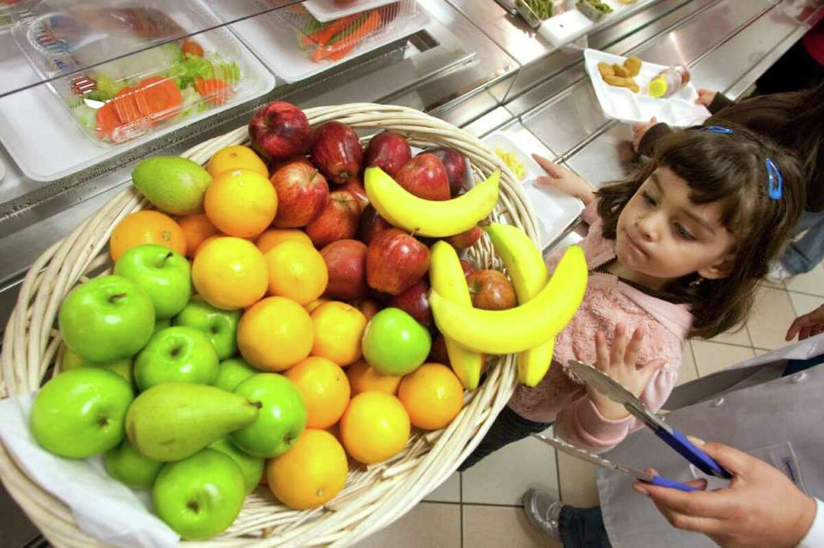 Pre-kindergarten student Jasmine Magana has plenty fruit to choose from for her lunch at Ponderosa Elementary School in Houston. First lady Michelle Obama, in her fight against obesity in children, announced new school lunch nutritional guidelines on Wednesday.
