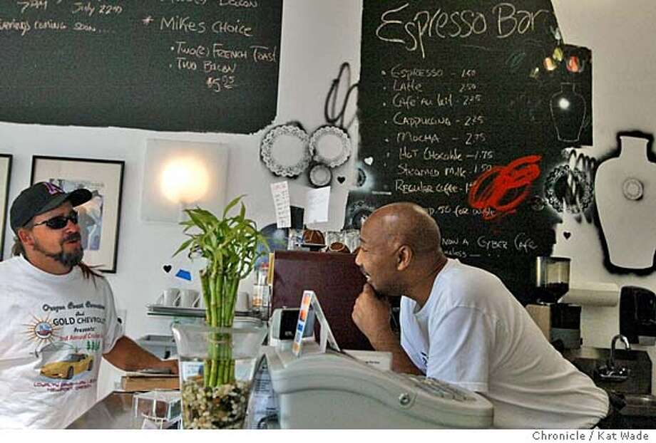 Otis Timmons (right), owner of Raphael's Shutter Cafe, chats with customer Lance Bauer. Chronicle photo by Kat Wade