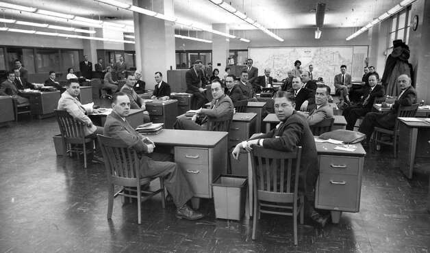 P-I circulation staff in the late 1940s (likely 1948) in the Sixth and Wall building. The area where this photo was taken will soon be home to offices for City University Seattle. Photo: Seattlepi.com File