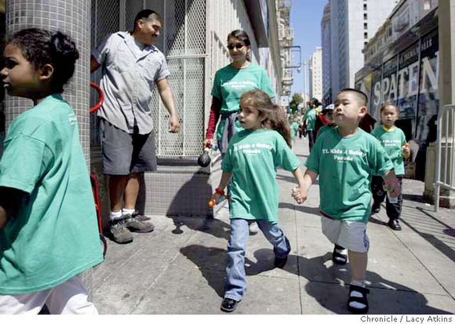 Lauran Blanco and Nicholas Wong, hand in hand , were among the hundreds of children of the Tenderloin marching around the block of Boeddecker Park, Wed. July 21, 2004, in San Francisco.About 200 kids of the Tenderloin march through their sad, crime ridden neighborhood in an effort to show the city that kids live there and they want more services. July 21, 2004. LACY ATKINS / The Chronicle Photo: LACY ATKINS