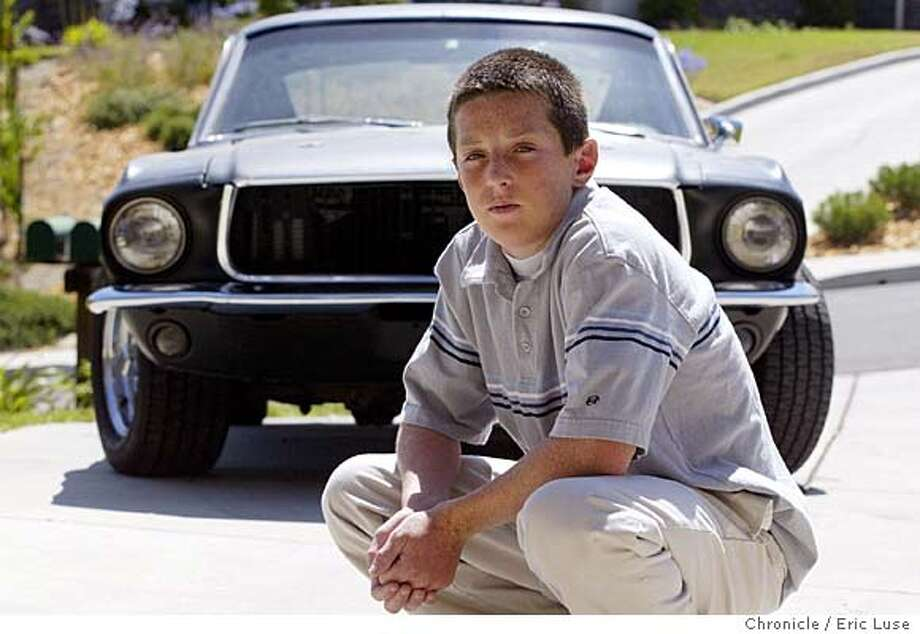 Danny Duffy,15, at his home with his 68 Mustang his father is helping him restore. They also found a written time capsule under the floorboards from a prior owner.  One of the Sonoma County Mustang Club�s youngest members, Danny Duffy of Healdsburg, 15, developed a new wine at the family winery (Optima Cellars Winery) to pay for restoration of his own classic Mustang. He will be at the Mustang 40th anniv. celebration in Healdsburg. Eric Luse / The Chronicle Photo: Eric Luse