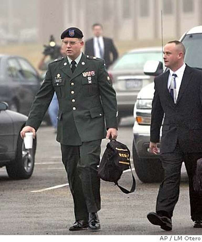 U.S. Army Spc. Charles Graner, left, arrives with an unidentified escort for the start of his military trial at Fort Hood, Texas, Monday, Jan. 10, 2005. Graner, the accused ringleader in the Abu Ghraib prisoner abuse scandal, is the first soldier to be tried in the case. (AP Photo/LM Otero) Photo: LM OTERO