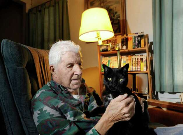 Eugene Clark, 96, with his black cat, Mike, in his Ashuelot home, New Hampshire, Wednesday, Jan. 25, 2012. Clark talked to murder victim Mary Harrison shortly before she disappeared in 1981. Harrison, a Greenwich native, lived on Broad Brook Road, an isolated section of the same road that Clark lives on. Photo: Bob Luckey / Greenwich Time